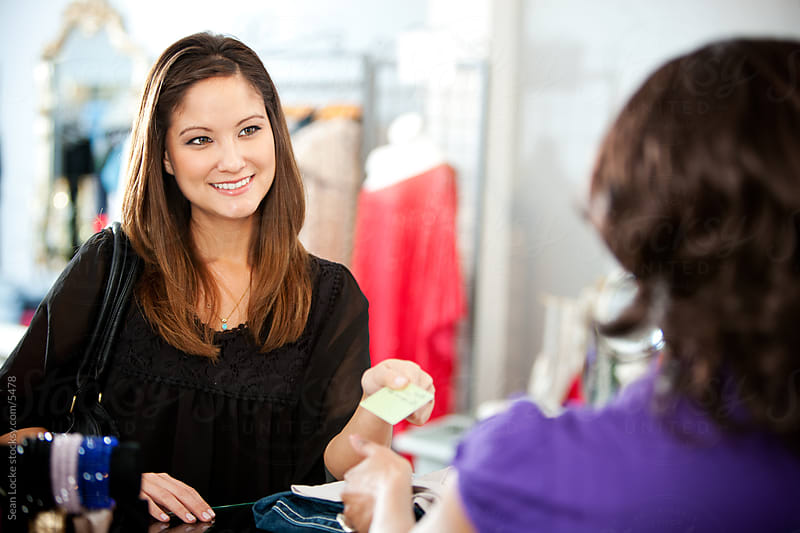 Boutique: Woman Making A Purchase with Credit Card by Sean Locke for Stocksy United