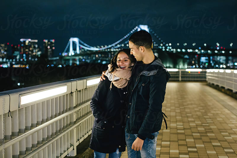 Young couple having fun in Tokyo at night. by BONNINSTUDIO for Stocksy United