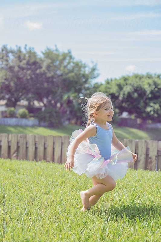Little Girl Giggles and Laughs While Playing Outside by suzanne clements for Stocksy United