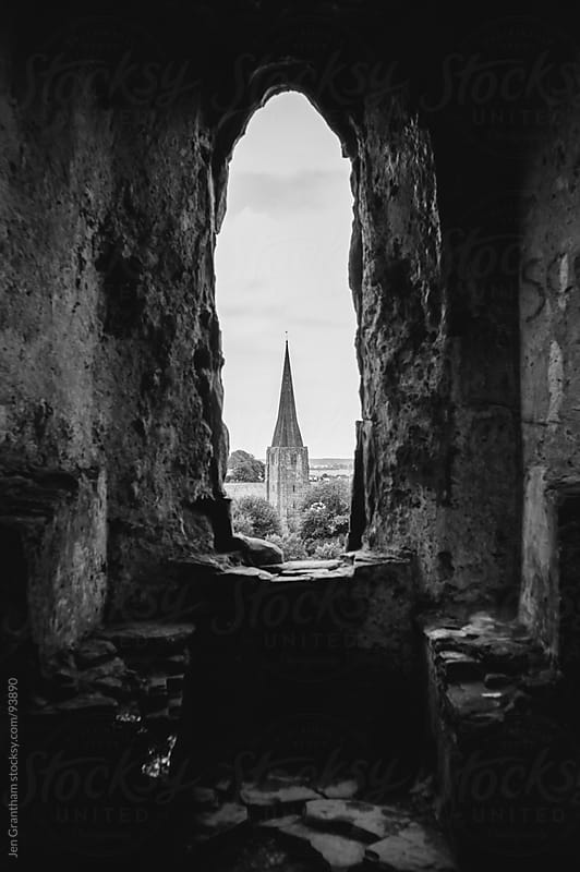 Tower through castle window by Jen Grantham for Stocksy United