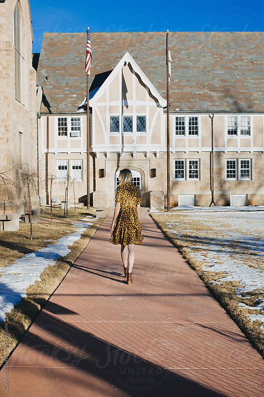 Beautiful Girl in Vintage Dress Walking to/From an Old Building by Gabrielle Lutze for Stocksy United