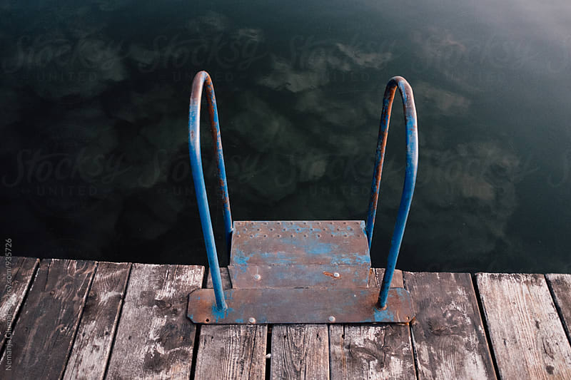 Metal Stairs at the Dock Leading Into the Lake by Nemanja Glumac for Stocksy United