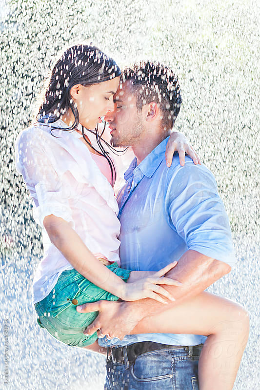 Kissing In The Rain by Lumina for Stocksy United