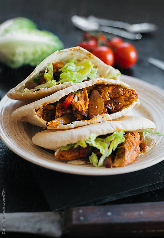 Chicken pita kebab. by Darren Muir for Stocksy United