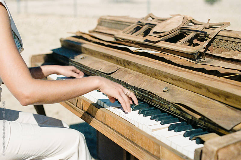 Woman's Hands Playing a Decrepit Old Broken Piano Outdoors by Briana Morrison for Stocksy United