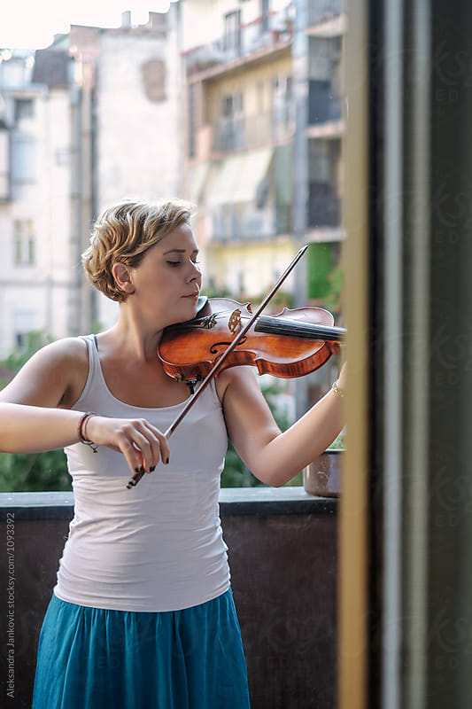 Young Woman Playing Violin  by Aleksandra Jankovic for Stocksy United