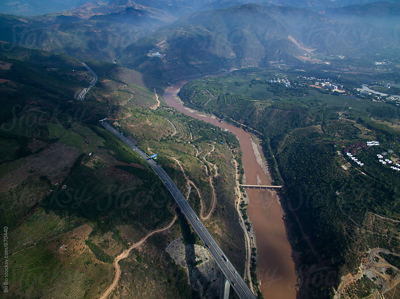 highway bridge across the river in the mountain  by cuiyan Liu for Stocksy United