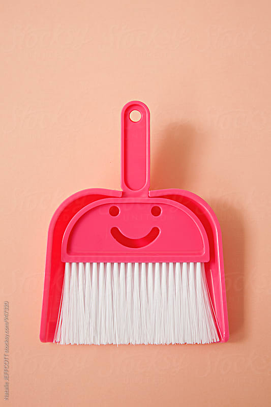 Cute pink dustpan and brush with smiley face by Natalie JEFFCOTT for Stocksy United