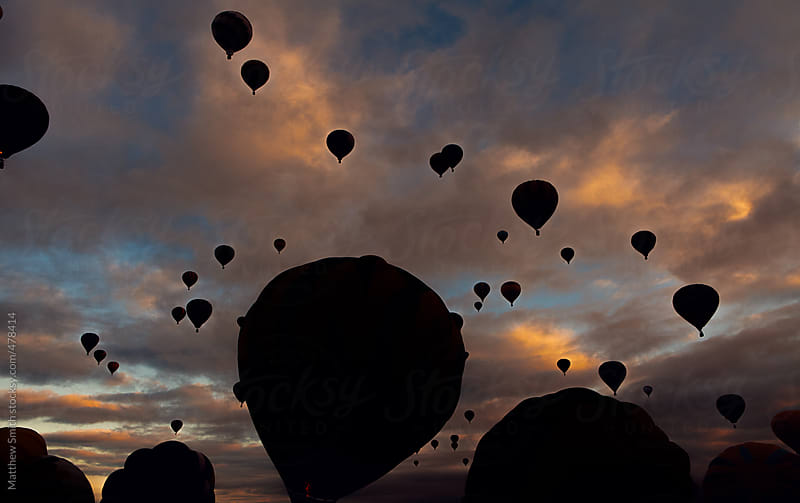 Group Of Hot Air Balloons Ascending In The Early Morning At The International Balloon Fiesta by Matthew Smith for Stocksy United