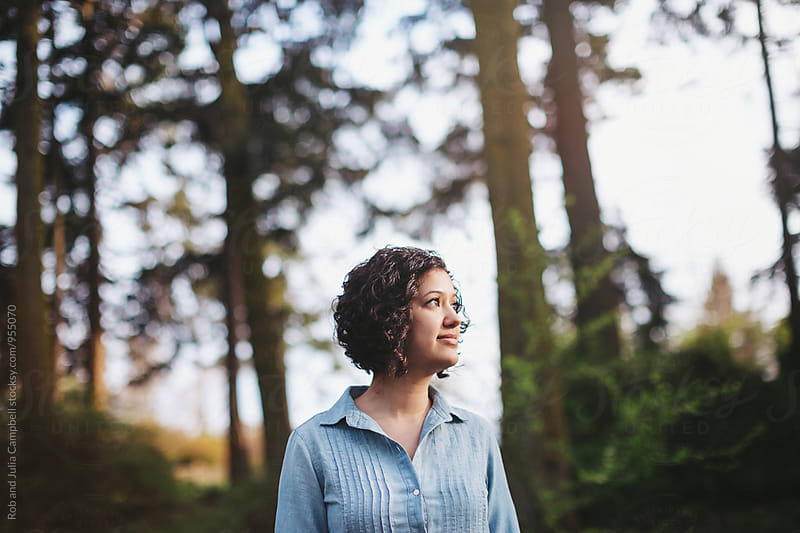 Portrait of young happy woman hanging out in nature by Rob and Julia Campbell for Stocksy United