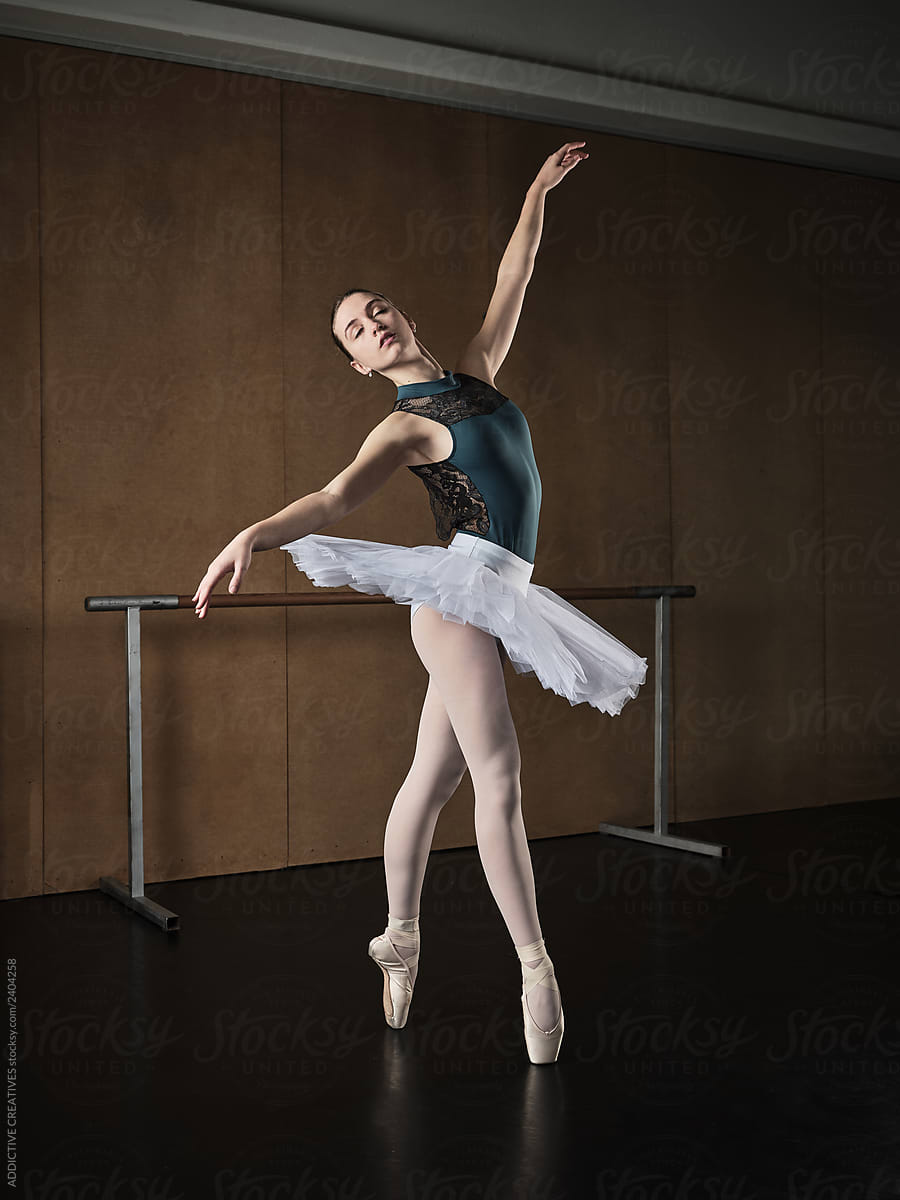 Graceful woman performing ballet positions by ADDICTIVE