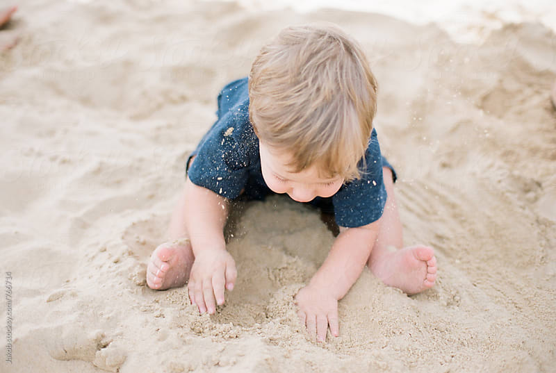 Young boy playing in sand by Jakob for Stocksy United