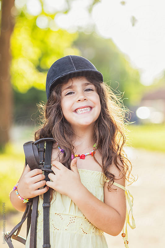 Smiling Girl With Riding Equipment by Lumina for Stocksy United