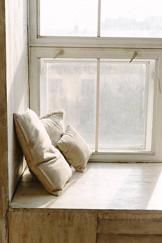 Photo of three beige pillow on window sill by Andrey Pavlov for Stocksy United