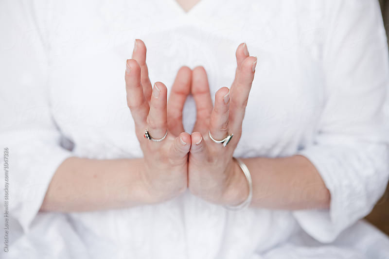 Woman doing yoga mudra by Christine Hewitt for Stocksy United