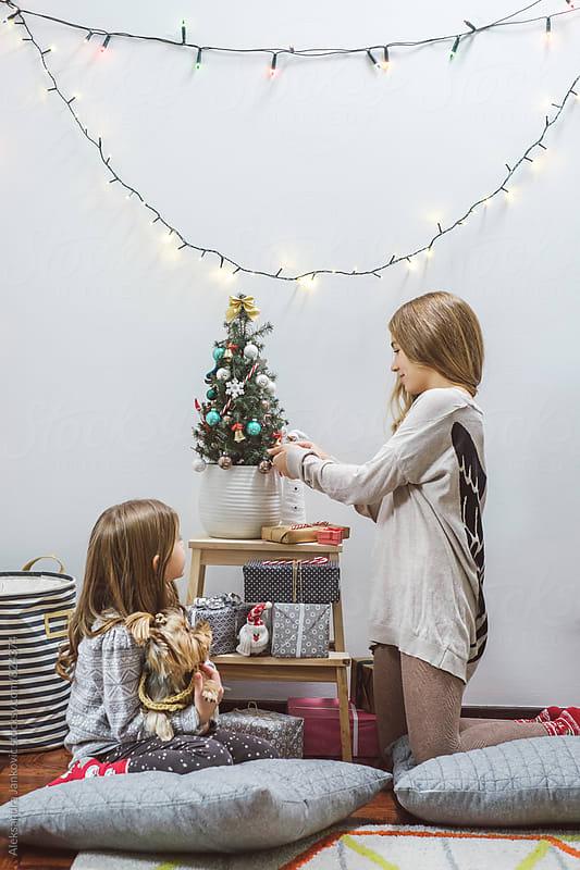 Children Decorating a Christmas Tree  by Aleksandra Jankovic for Stocksy United