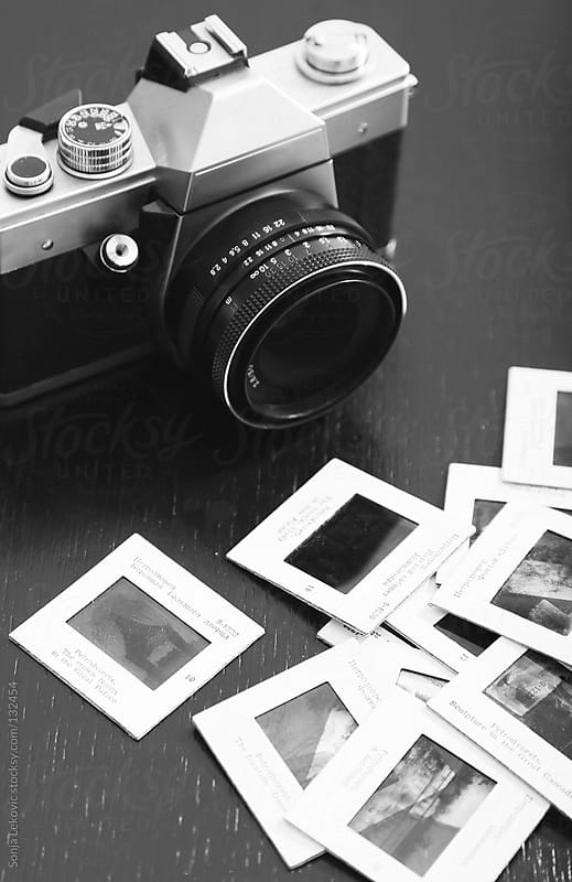 retro camera and slides by Sonja Lekovic for Stocksy United
