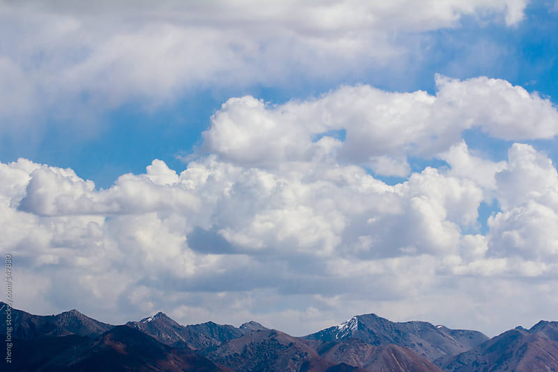 The mountains and clouds,in western China by zheng long for Stocksy United