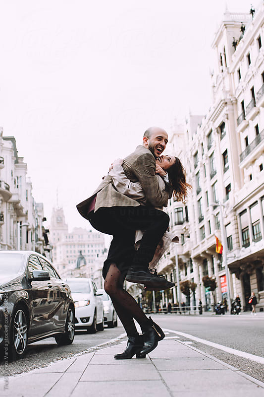 couple having fun in the street by Thais Ramos Varela for Stocksy United