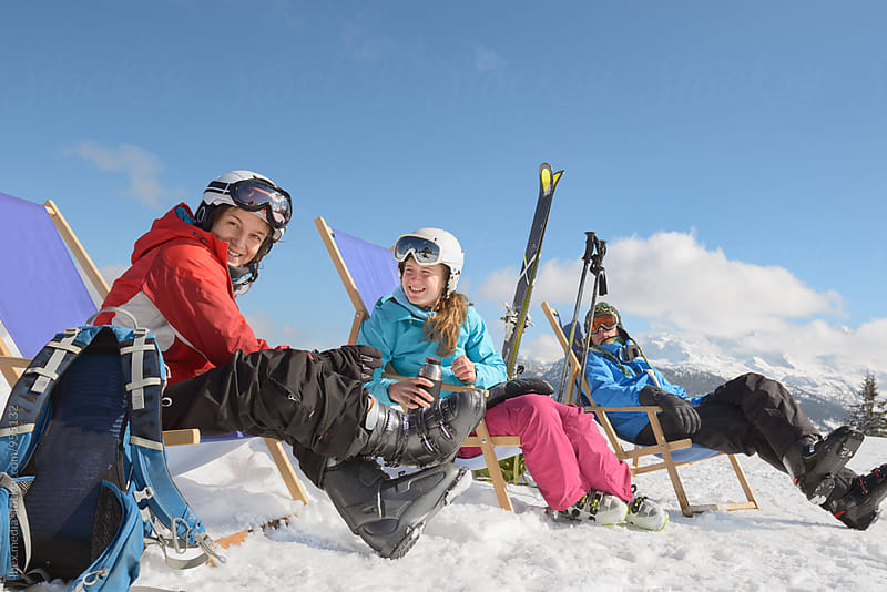 Group of friends taking a break on the ski slope by RG&B Images for Stocksy United