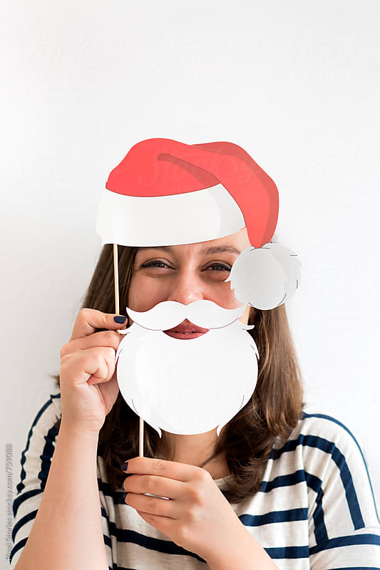 Joyful young woman in Santa disguise  by Pixel Stories for Stocksy United