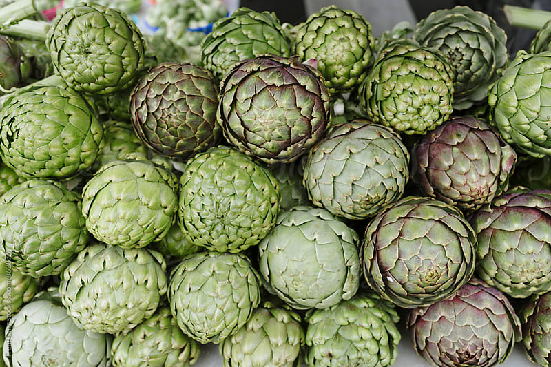 Farmers Market fresh organic artichokes by Trent Lanz for Stocksy United