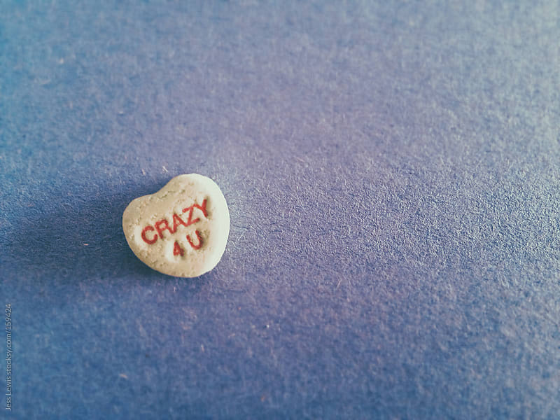 candy heart with crazy 4 u text by Jess Lewis for Stocksy United