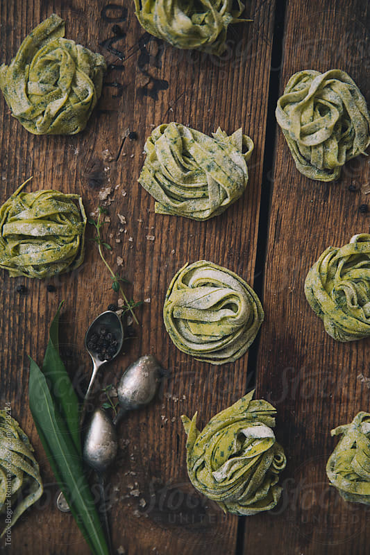 Homemade pasta with wild garlic by Török-Bognár Renáta for Stocksy United