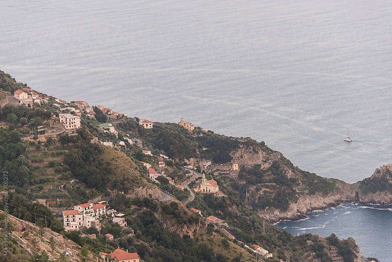 A small village on a steep hill next to the ocean by Mike Marlowe for Stocksy United
