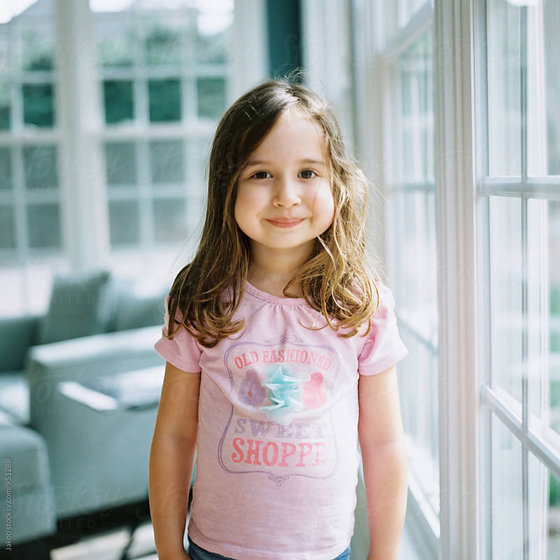 Portrait of a cute happy young girl  by Jakob for Stocksy United