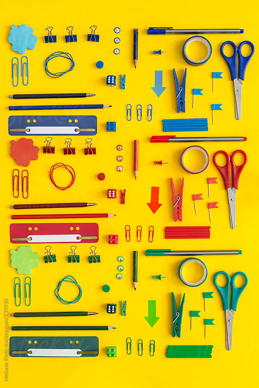 Red, Green and Blue office tools on yellow background by Melanie Kintz for Stocksy United