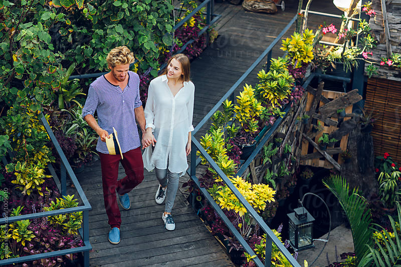 Couple Having a Walk in a Tropical Garden by Lumina for Stocksy United