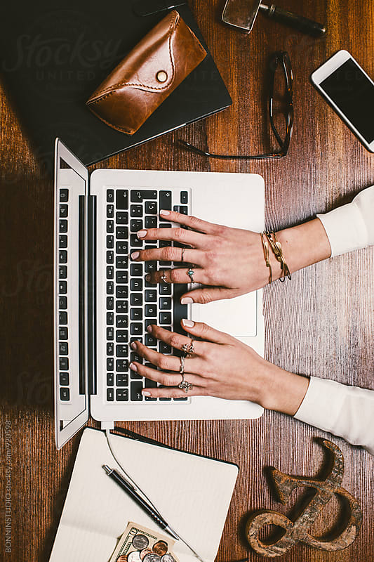 Woman's hands working on wooden workspace. by BONNINSTUDIO for Stocksy United