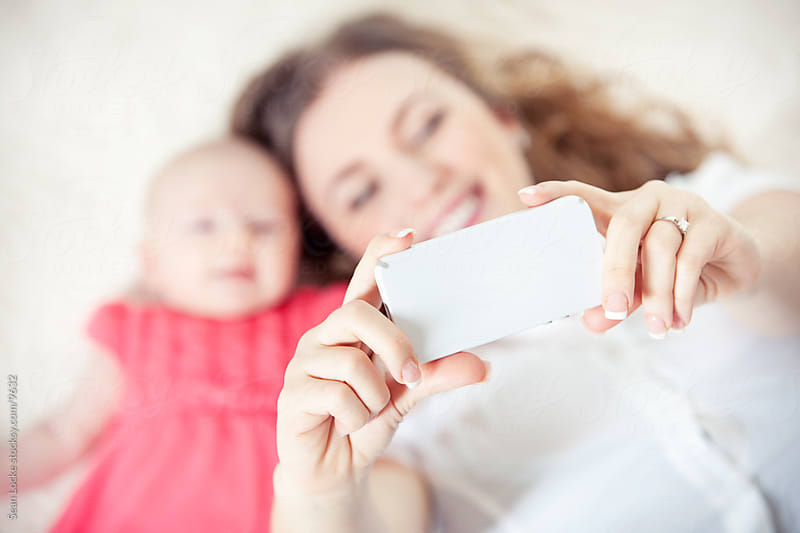Baby: Mom Taking Self Portrait with Baby by Sean Locke for Stocksy United