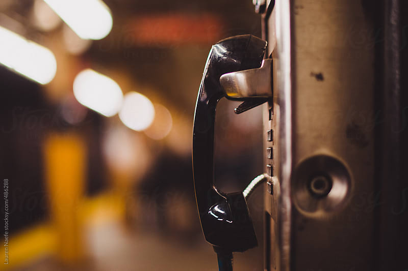 Pay phone in subway station by Lauren Naefe for Stocksy United