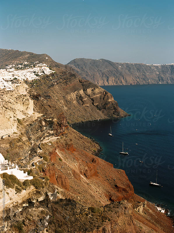View of village on cliff, Santorini by Kirstin Mckee for Stocksy United
