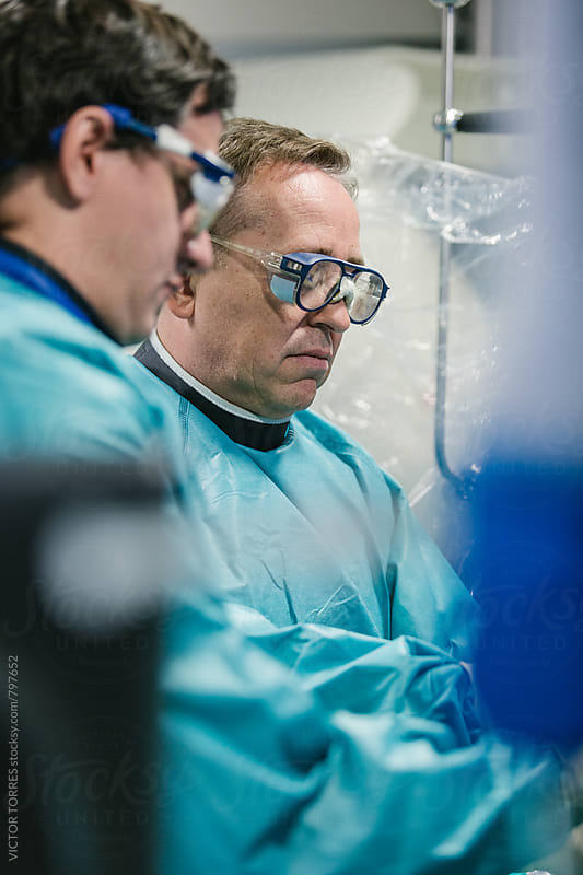 Doctors Operating Using Robot-Assisted Surgery by VICTOR TORRES for Stocksy United