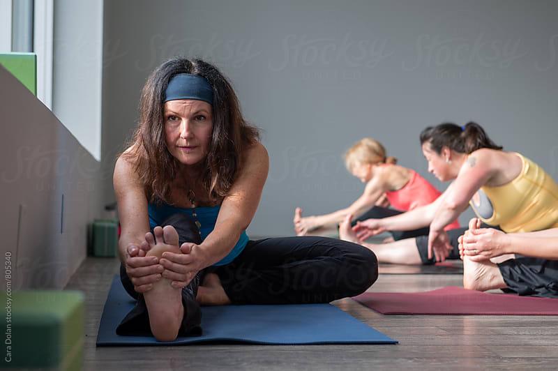 Yoga class in a modern studio by Cara Slifka for Stocksy United