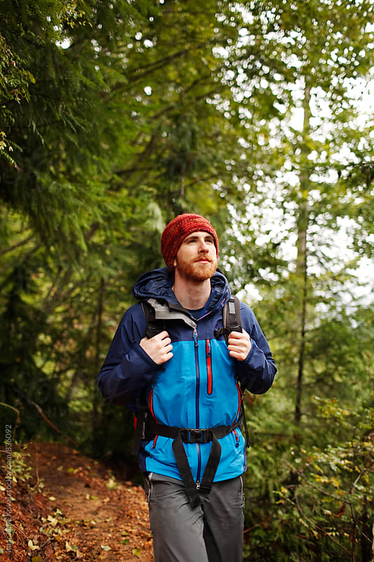 Man hiking in the Pacific Northwest by Isaac Lane Koval for Stocksy United
