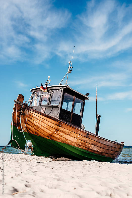 Traditional fishing boat at the shore by Claudia Lommel for Stocksy United