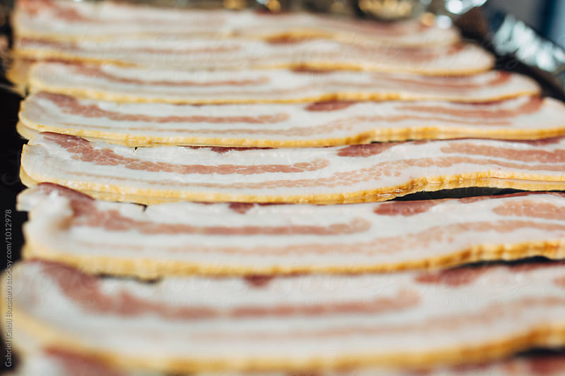 Raw bacon closeup by Gabriel (Gabi) Bucataru for Stocksy United