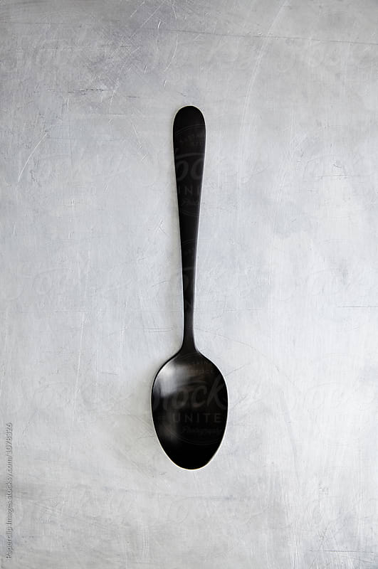 Kitchen utensils - Black spoon by Paperclip Images for Stocksy United