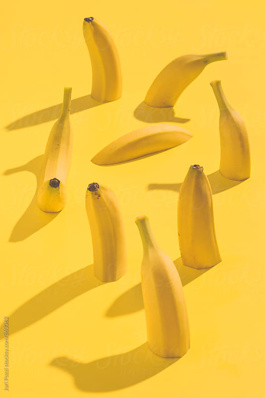 Banana on a yellow background by Juri Pozzi for Stocksy United