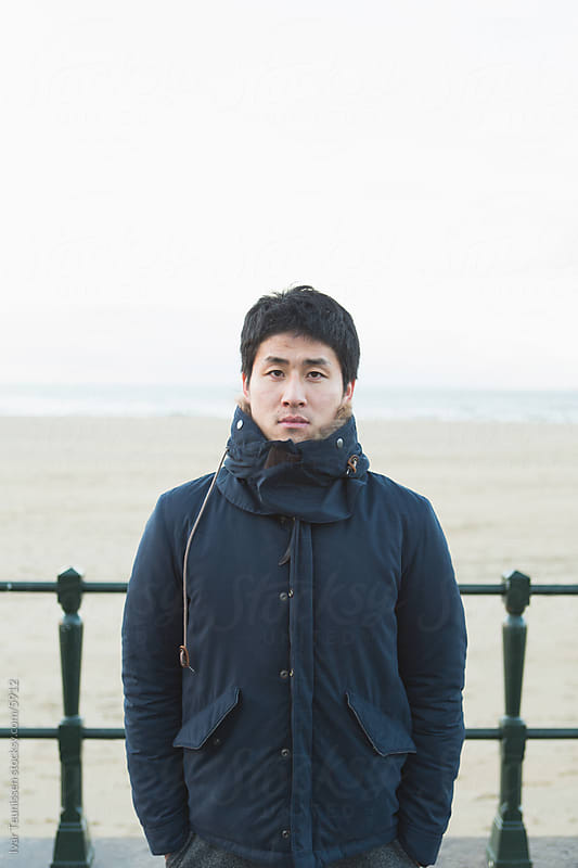 Japanese man on beach by Ivar Teunissen for Stocksy United