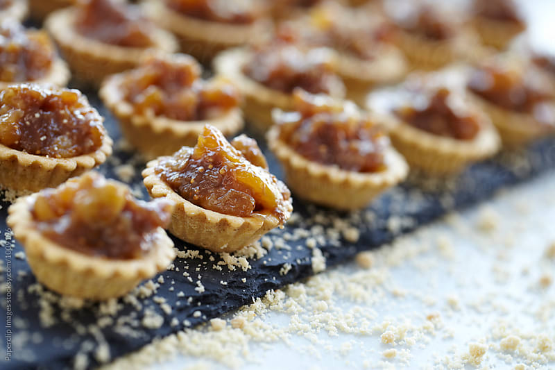 Freshly prepared tartlets by Paperclip Images for Stocksy United