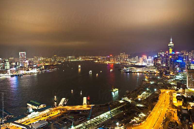 Night View of Victoria Harbour, Hong Kong by Jill Chen for Stocksy United