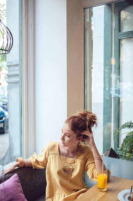Ginger Woman Sitting in a Cafe by Lumina for Stocksy United