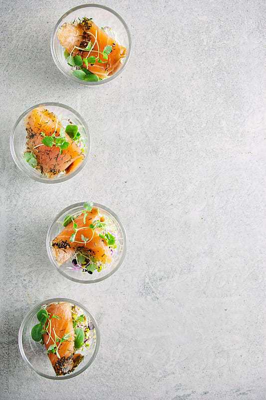Smoked salmon appetizers served in shot glasses,seen from overhead. by Darren Muir for Stocksy United