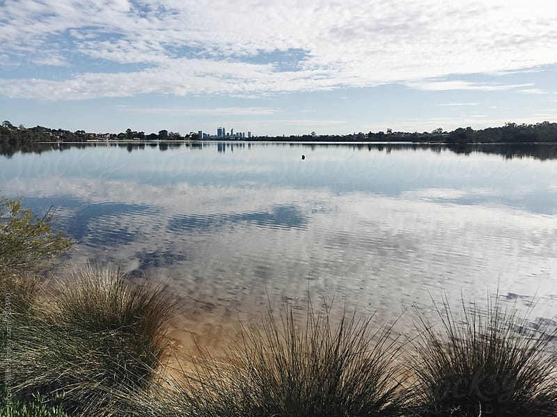 Morning view across Canning River toward Perth city, Western Australia by Jacqui Miller for Stocksy United
