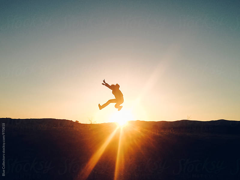 Silhouette man jumping outdoor in the sunset by Blue Collectors for Stocksy United